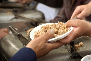 handing plate of food to open hand