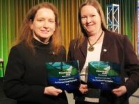 ladies hold glass awards