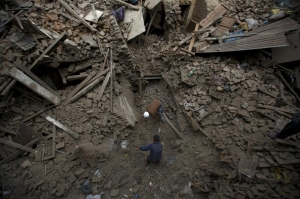 People search for family members trapped inside collapsed houses. Navesh Chitrakar / Reuters