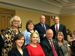 members pose before finance committee hearing