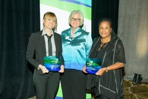 kristi, suzanne and Mrs. Shinn pose with glass awards