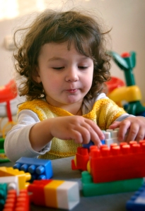 child plays with cubes 1